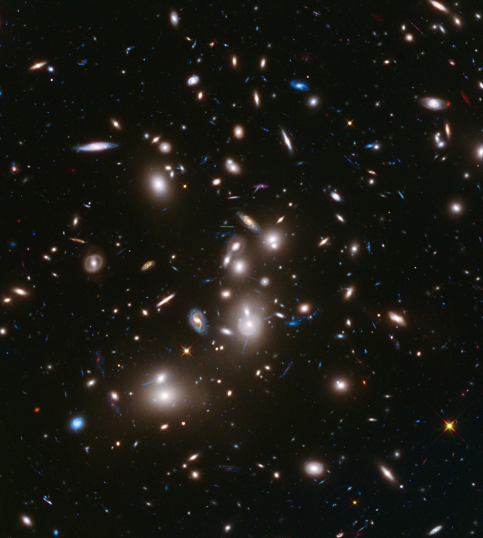 The immense gravity in this foreground galaxy cluster, Abell 2744, warps space to brighten and magnify images of far-more-distant background galaxies as they looked over 12 billion years ago, not long after the big bang.  This is the first of the Frontier Fields to be imaged.