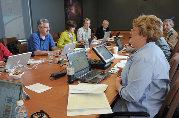 The time allocation committee (TAC) discusses which proposals will receive observing time on Hubble.