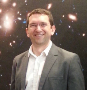 Dan Coe, ESA/AURA Astronomer, in front of the first Frontier Fields image, Abell 2744.