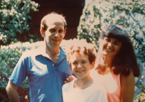 Dan, at the age of 11, poses with his mom and dad.