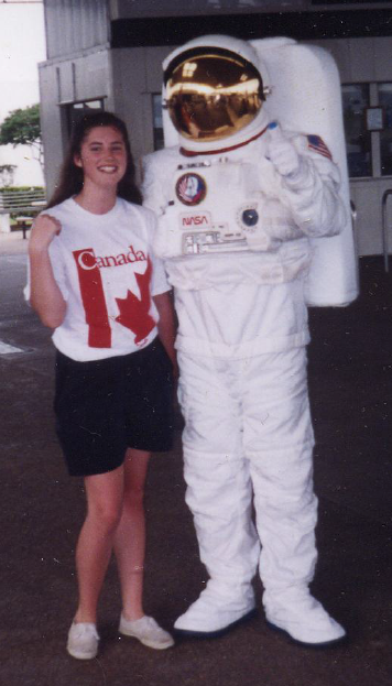 Tricia Royle poses with an astronaut at Kennedy Space Center.