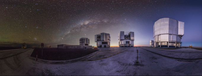 A composite image of sunset and midnight at the Very Large Telescope at Cerro Paranal, Chile.